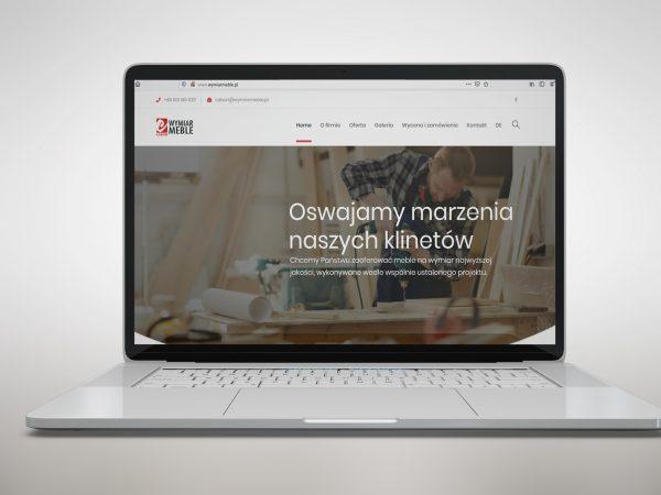 <span>Projekt strony</span><i>→</i>